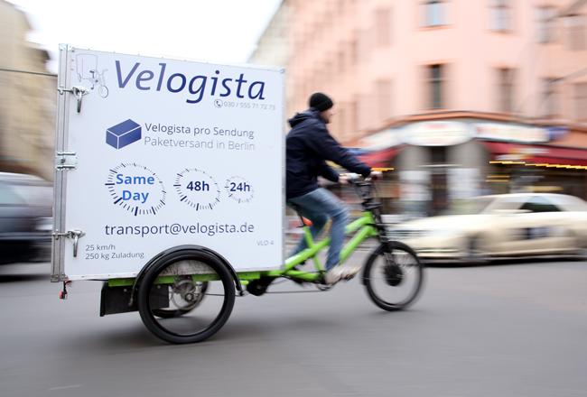 Die Elektro-Lastenräder der Velogista GmbH fahren mit 100 % Ökostrom und können mit einer Nutzlast bis zu 250 kg beladen werden. (Copyright: Velogista GmbH)