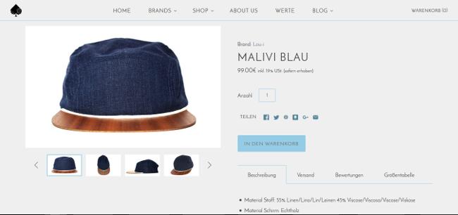 Diese besondere Cap mit Holzschirm der Marke Lou-i kann im New Hand Shop gekauft werden. © New Hand