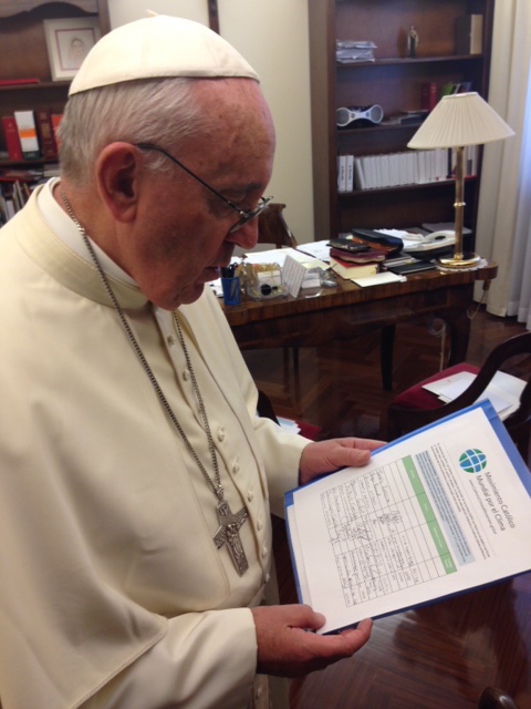 Pope Francis holds the Catholic Climate Petition in his personal office © GCCM